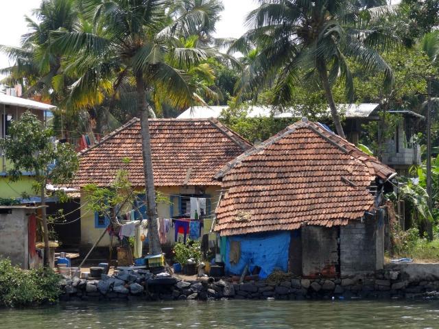 "<img src=""49d23-dsc01901.jpg"" alt=""Shanty house Kochi India"" />"